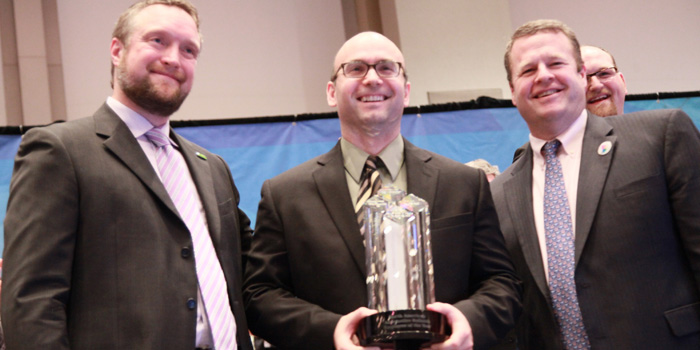Gordon Erdelean (center) receives his Employee of the Year award from Paul Whittleston (left) and Chris Toomey, senior vice president, Coatings Solutions North America.