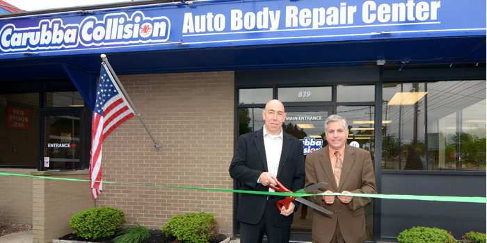 From left, Carubba Collision Corp. President and CEO Joe Carubba and Jamestown, N.Y., Mayor Sam Teresi cut the ribbon at the grand opening of Carubba Collision's new Jamestown, N.Y., location.