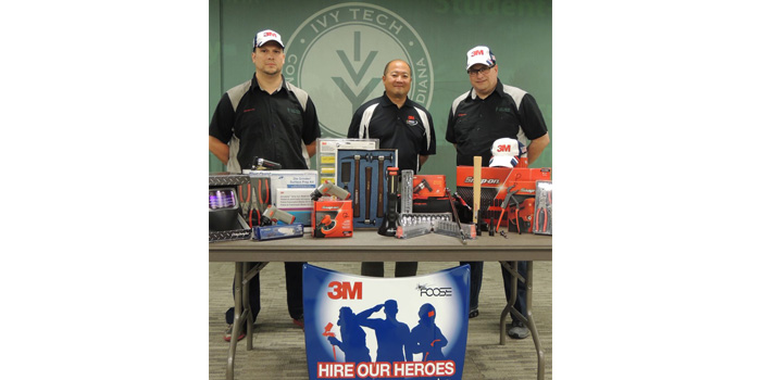 Ivy Tech Northeast automotive technology student Gabriel Davis (left) and graduate Paul Hyde (right) display $3,000 in tools and equipment that each individual selected as a recipient of the Collision Repair Education Foundation's 3M Hire Our Heroes tool grant for 2015. Both men are joined by Randy Minobe, senior account representative with the 3M Automotive Aftermarket Division.