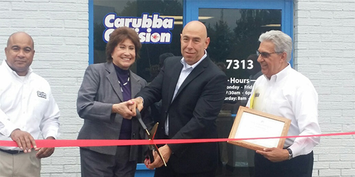 From left, Yves Pierre, shop manager; Supervisor Jessica Zambrano; Carubba Collision Corp. President Joe Carubba and Carubba Collision Public & Community Relations Manager, Lou Fasolino, cut the ribbon at the Official Grand Opening of Carubba Collision's new Syracuse, N.Y., shop.