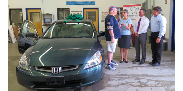 Gonzales receiving the key to his 2004 Honda Accord.
