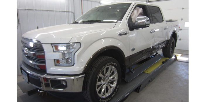 One of the damaged 2015 Ford F-150s that came to Carlson's Collision & Glass. Time to learn and earn!