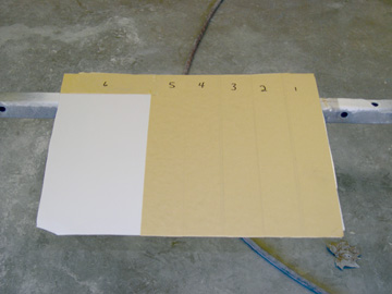 here the white panel has been taped off with five strips of 2-inch masking tape, leaving one section exposed.