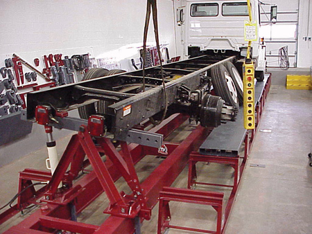 As one might suspect, frame repair equipment for the heavy truck collision repair business is much larger than the frame racks used in the repair of passenger cars. The system above is being used to push a twist out of the frame of a truck. (Photo courtesy of Bee Line Company)